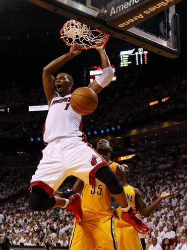 Chris Bosh dunked for 2 of his 25 points in Miami's Game 6 rout of Indiana. The Heat led by as many as 37 points.